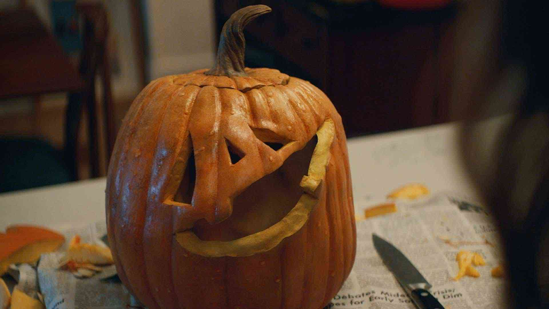 Thumbnail for a commercial for KitKat called 'Pumpkin' showing a jack-o'-lantern with a tilted mouth.