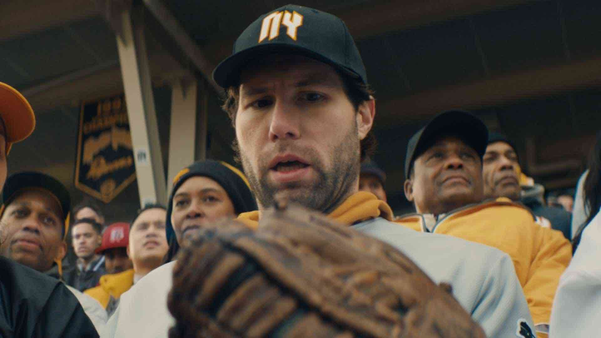 Thumbnail for a commercial for the New York Lotto called 'Glove' showing a man at a stadium holding a baseball glove.